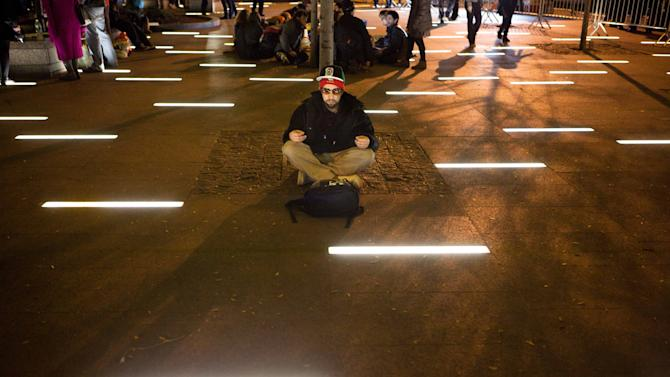 An Occupy Wall Street protestor meditates in a newly tent-free Zuccotti Park during the early morning hours, Wednesday, Nov. 16, 2011, in New York. Crackdowns against the Occupy Wall Street encampments across the country reached the epicenter of the movement Tuesday, when police rousted protesters from a Manhattan park and a judge ruled that their free speech rights do not extend to pitching a tent and setting up camp for months at a time. (AP Photo/John Minchillo)