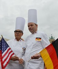 US chef Cristeta Comerford (L) and Germany's Ulrich Kerz pose in Berlin. World leaders' personal chefs, a group known as one the globe's most exclusive culinary clubs, gathered in Berlin Thursday to swap tips on how to keep their powerful bosses healthy and happy