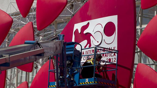 Workers prepare the logo on the Palace of Cinema at the 69th edition of the Venice Film Festival at Venice Lido, Italy, Tuesday, Aug. 28, 2012. The world's oldest movie festival will open on Aug. 29th through Sept. 8. (AP Photo/Joel Ryan)