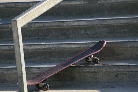 Photo of a skateboard on a set of concrete steps