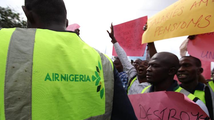 "Former Air Nigeria staff protest after they were fired in Lagos, Nigeria, Friday, Sept. 7, 2012. More than 60 workers from Air Nigeria protested Friday at Lagos' Murtala Muhammed International Airport's domestic terminal, demanding four-months-worth of unpaid salaries from the company. The airline's owner, business tycoon Jimoh Ibrahim, fired nearly all of the company's 800 employees for ""disloyalty"" earlier this month. (AP Photo/Jon Gambrell)"