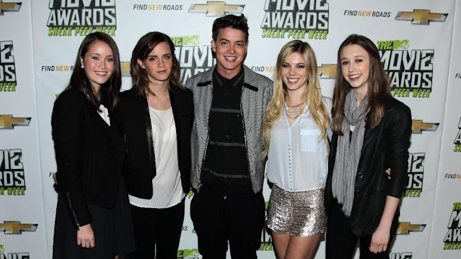 "IMAGE DISTRIBUTED FOR MTV - Cast members of ""The Bling Ring"", from left, Katie Chang, Emma Watson, Israel Broussard, Claire Julien and Taissa Farmiga are seen at ""The MTV Movie Awards Sneak Peek Week"" on Friday, April 12, 2013 in Universal City, Calif. (Photo by Matt Sayles/Invision for MTV/AP Images)"
