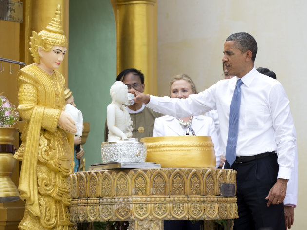 """President Barack Obama """"douses eleven flames"""" as he tours the Shwedagon Pagoda with Secretary of State Hillary Rodham Clinton in Yangon, Myanmar. Little noticed during Obama's landmark visit to Myanmar was a significant concession that could shed light on whether that nation's powerful military pursued a clandestine nuclear weapons program, possibly with North Korea's help."""