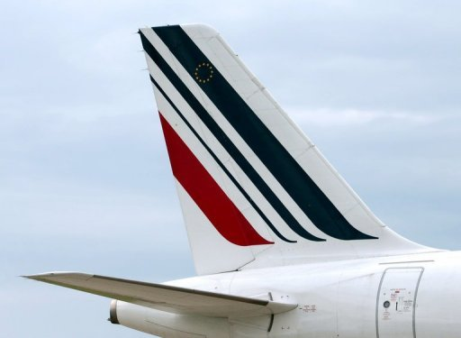 <p>Tail of an Air France plane at the Roissy airport in Roissy-en-France, near Paris. Three unions representing ground staff have agreed to plans by Air France to slash over 5,000 jobs by 2014 as part of a vast plan to make the struggling airline profitable, sources said.</p>