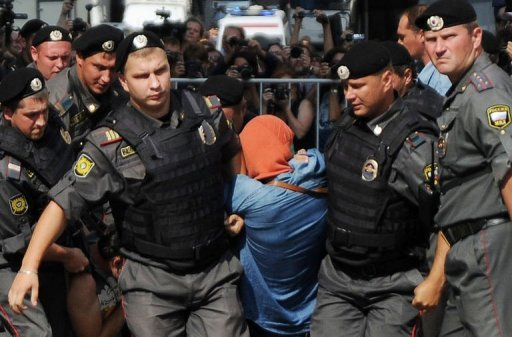 &lt;p&gt;Russian riot policemen detain a supporter of all-girl punk band &quot;Pussy Riot&quot; near a court building in Moscow on Agust 17, 2012. An unidentified computer hacker broke into the official website of a Moscow court that sentenced Pussy Riot band members to jail, defacing its front page with obscenities and an anti-Vladimir Putin slogan, a court spokeswoman said Tuesday.&lt;/p&gt;