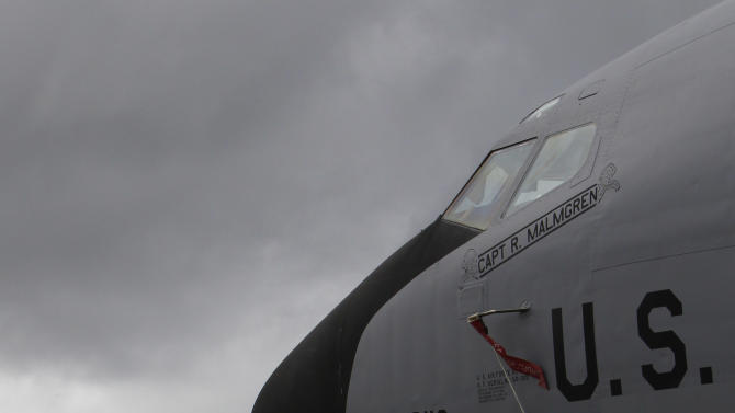 In this Aug. 14, 2012 photo, a ground crew member stands in front of a U.S. Air Force KC-135 Stratotanker, which was built in 1958, at Kadena Air Base on Japan's southwestern island of Okinawa. For decades, the U.S. Air Force has grown accustomed to such superlatives as unrivaled and unbeatable. Now some of its key aircraft are being described with terms like decrepit.  (AP Photo/Greg Baker)