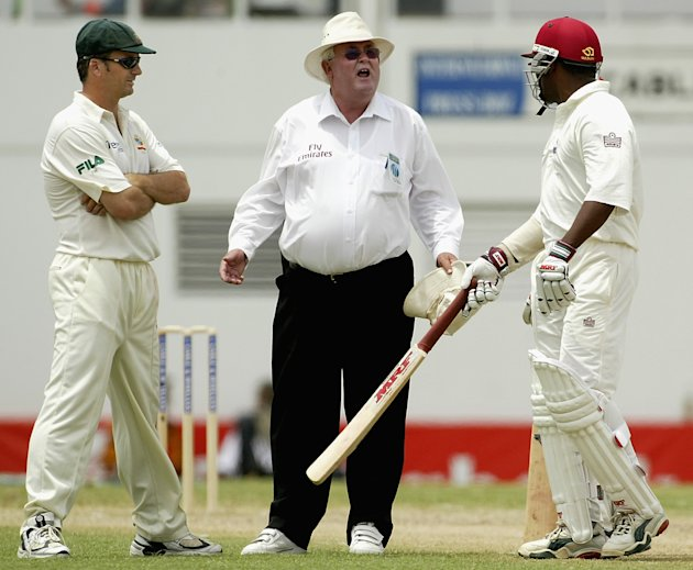 Umpire David Shepherd comes between Steve Waugh of Australia and Brian Lara of the West Indies