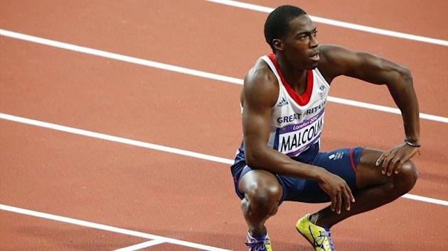 Britain's Christian Malcolm looks at the clock after his men's 200m semi-final during the London 2012 Olympic Games at the Olympic Stadium August 8, 2012.