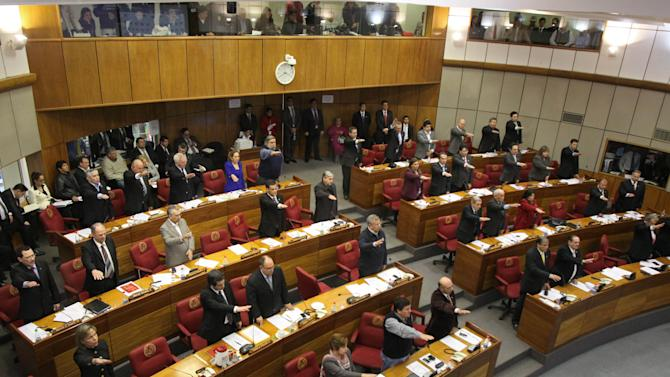 Senators vote in favor of beginning impeachment proceedings for Paraguay's President Fernando Lugo in Asuncion, Paraguay, Thursday, June 21, 2012. President Lugo is scheduled to appear in the senate on Friday. (AP Photo/Cesar Olmedo)