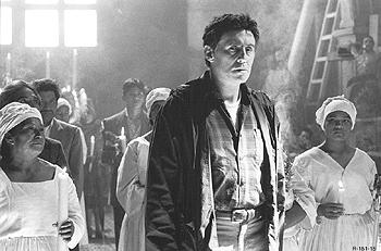 Gabriel Byrne as Andrew Kiernan, a scientist and Vatican priest who investigates strange phenomena, in Stigmata