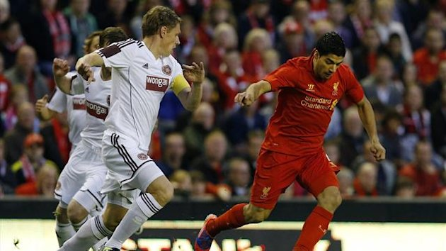 Liverpool's Luis Suarez (R) challenges Hearts' Marius Zaliukas during their Europa League soccer match at Anfield in Liverpool, northern England August 30, 2012 (Reuters)