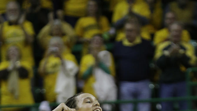Baylor center Brittney Griner (42) celebrates after she scored 50 points during the second half of an NCAA college basketball game against Kansas State, Monday, March 4, 2013, in Arlington, Texas. Baylor won 90-68 and Griner marked a Big 12 single game scoring record. (AP Photo/LM Otero)