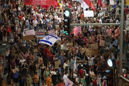 Israeli protesters take part in a demonstration in Tel Aviv. A protester was in hospital in a serious condition after setting himself alight at a march for social justice in Tel Aviv late Saturday, police said