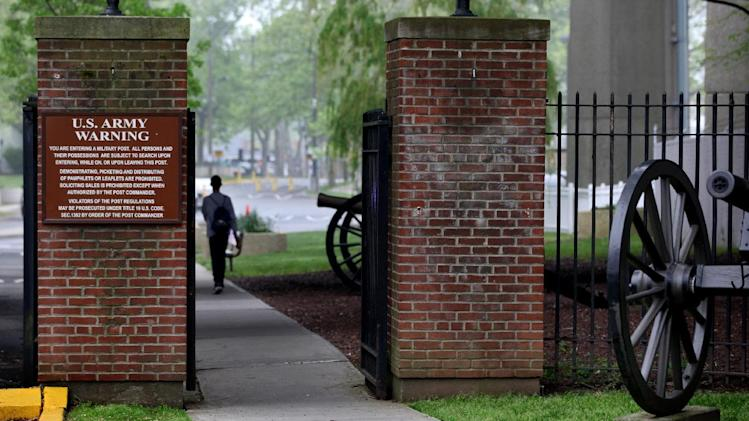 A person walks towards the security gate at Fort Hamilton, in the Brooklyn borough of New York, check vehicles as they enter the base Saturday, May 5, 2012. Families who lost loved ones in the Sept. 11, 2001 attacks, will be able enter the base and watch the arraignment of Khalid Sheikh Mohammed, that will be broadcast on closed-circuit TV to Fort Hamilton, Fort Meade, Md., and Fort Dix, N.J. (AP Photo/Craig Ruttle)