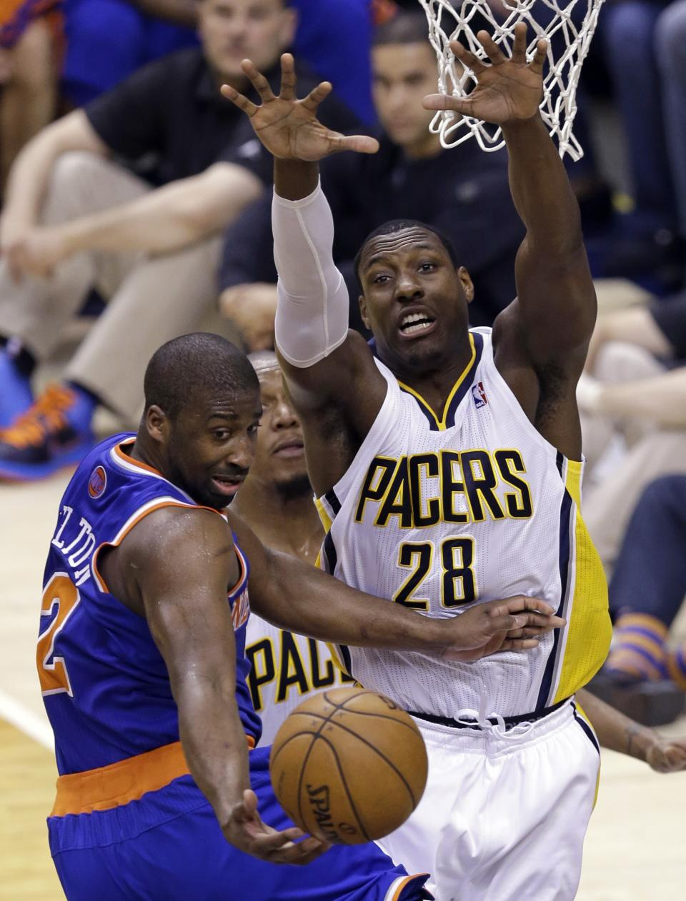 Indiana Pacers center Ian Mahinmi (28) forces New York Knicks guard Raymond Felton to pass on a drive to the basket during the first half of Game 4 of the Eastern Conference semifinal NBA basketball playoff series, in Indianapolis on Tuesday, May 14, 2013. (AP Photo/Michael Conroy)