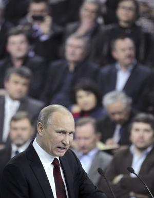 Russian Prime Minister and presidential candidate Vladimir Putin  speaks during his meeting with his campaign activists in Moscow on Wednesday, Feb. 29, 2012. Putin warned the opposition against using illegal ways to protest the outcome of Sunday's election, in which he is all but certain to reclaim the presidency. (AP Photo/Maxim Shipenkov, pool)