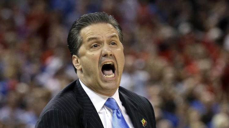 Kentucky head coach John Calipari calls to his team during the first half of an NCAA Final Four semifinal college basketball tournament game Saturday, March 31, 2012, in New Orleans. (AP Photo/David J. Phillip)