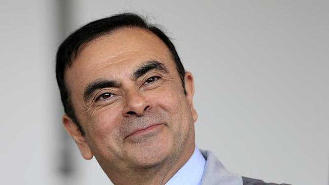 Carlos Ghosn, Chairman and CEO of the Renault-Nissan Alliance attends a visit to the Renault automobile factory in Flins, west of Paris