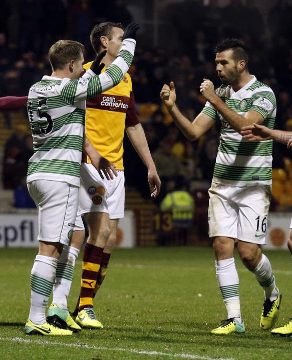 Celtic's Kris Commons celebrates with teammate Joe Ledley after scoring his goal against Motherwell during their Scottish Premier League soccer match at Fir Park Stadium in Motherwell
