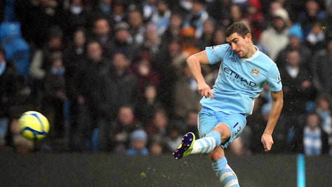 Manchester City's Aleksandar Kolarov, scores his goal from a free kick during their FA Cup third round soccer match against Manchester United at the Etihad stadium, Manchester, England, Sunday, Jan. 8, 2012. (AP Photo/Scott Heppell)