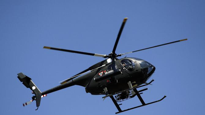 A military helicopter flies over Buenavista-Tomatlan, Michoacan State, Mexico, on January 14, 2014