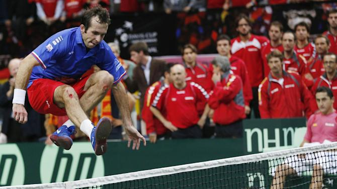 Czech Republic's Radek Stepanek celebrates by jumping over the net after defeating Spain's Nicolas Almagro in their Davis Cup finals tennis singles match in Prague, Czech Republic, Sunday, Nov. 18, 2012. Czech Republic defeated Spain 3-2 and gained the Davis Cup trophy. (AP Photo/Petr David Josek)
