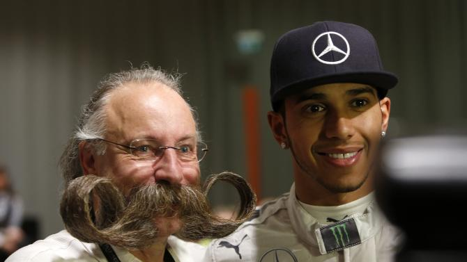 Formula One World Champion Hamilton poses with Beard World Champion Burkhardt after news conference at annual 'Stars & Cars' event in Stuttgart