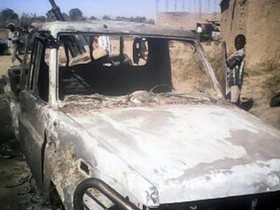 Raw: Burned Out Vehicles Litter Mali Streets