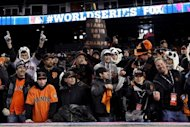 San Francisco Giants fans cheer after their team defeated the Detroit Tigers in the tenth inning to win Game Four of the Major League Baseball World Series at Comerica Park on October 28, 2012 in Detroit, Michigan