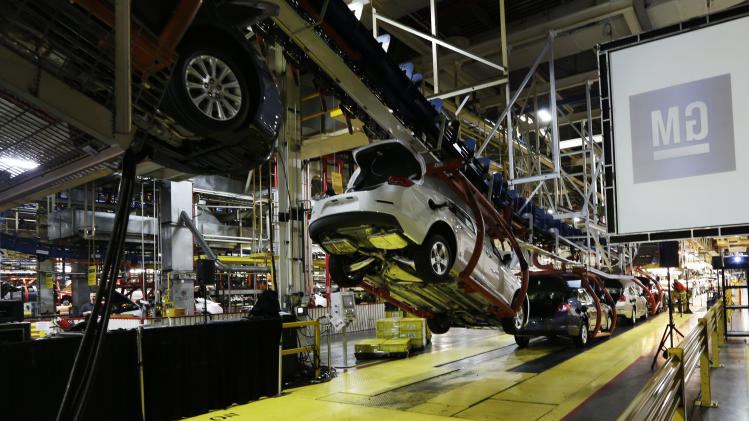 In this Monday, Jan. 28, 2013 file photo, cars move along an assembly line at the General Motors Fairfax plant in Kansas City, Kan. General Motors releases its fourth quarter of 2012 financial earnings, Thursday, Feb. 14, 2013. (AP Photo/Orlin Wagner, File)