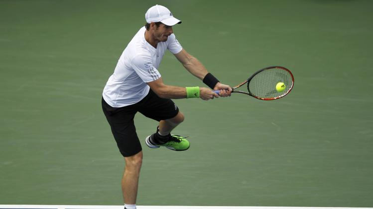 Andy Murray of Britain hits a return to Andrey Kuznetsov of Russia during their match at the 2014 U.S. Open tennis tournament in New York