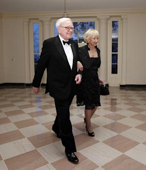 """FILE - In this March 14, 2012 file photo, Warren Buffett and Astrid M. Buffett arrive at the Booksellers area of the White House in Washington for the State Dinner hosted by President Barack Obama and first lady Michelle Obama for British Prime Minister David Cameron and his wife Samantha. A bill designed to enact President Barack Obama's plan for a """"Buffett rule"""" tax on the wealthy would rake in just $31 billion over the next 11 years, according to an estimate by Congress' official tax analysts obtained by The Associated Press. (AP Photo/Charles Dharapak, File)"""