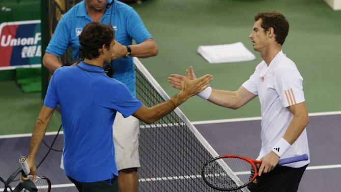 Andy Murray of Britain, right, shakes hand with Roger Federer of Switzerland after winning the semifinal in the  men's singles tennis match of the Shanghai Masters tennis tournament at Qizhong Forest Sports City Tennis Center in Shanghai, China, Saturday Oct. 13, 2012. Andy Murray won 6-4, 6-4. (AP Photo/Kin Cheung)