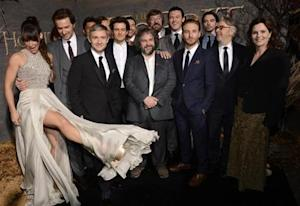 "Cast and crew members pose for photographers at the premiere of the film ""The Hobbit: The Desolation of Smaug"" in Los Angeles December 2, 2013. REUTERS/Phil McCarten/Files"