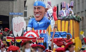 A carnival float in Cologne, Germany, depicts President Obama as comic book hero Captain America: Germany is one of many countries that overwhelmingly favors Obama over Mitt Romney.