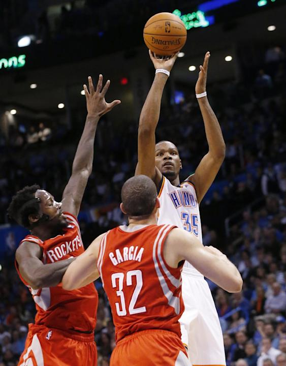 Oklahoma City Thunder forward Kevin Durant (35) shoots over Houston Rockets guard Pat Beverley (2) and guard Francisco Garcia (32) during the fourth quarter of an NBA basketball game in Oklahoma City,