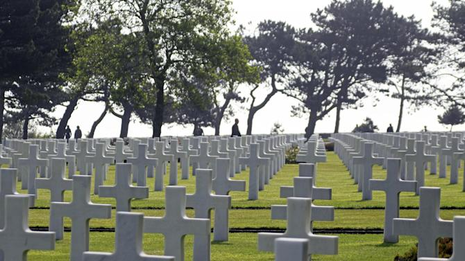 Visitors walk among the 9,387 tombs at the Colleville American military cemetery, in Colleville sur Mer, western France, Thursday June 6, 2013, on the day of the commemoration of the 69th anniversary of the D-Day.(AP Photo/Remy de la Mauviniere)