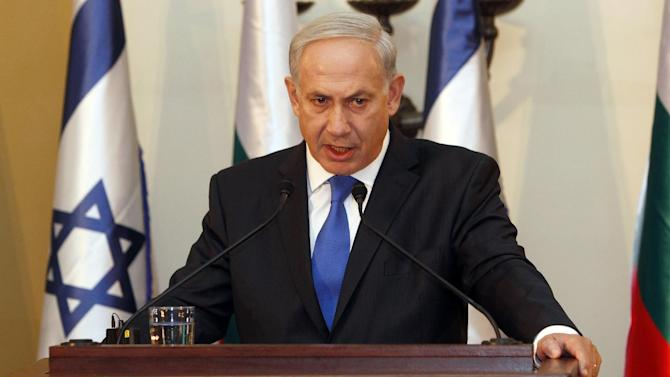 """FILE - In this Sept. 11, 2012, photo, Israeli Prime Minister Benjamin Netanyahu speaks during a joint press conference with his Bulgarian counterpart Boyko Borissov, not seen, in Jerusalem. Netanyahu is making a direct appeal to U.S. voters to elect a president willing to draw a """"red line"""" with Iran. Netanyahu on Sunday, Sept. 16, 2012, used this week's focus on unrest across the Muslim world to warn Americans watching two Sunday talk shows that time is running out to confront Tehran on its nuclear program. It was an impassioned election-season plea for a world leader who insists he doesn't want to insert himself into U.S. politics. (AP Photo/Gali Tibbon, Pool)"""