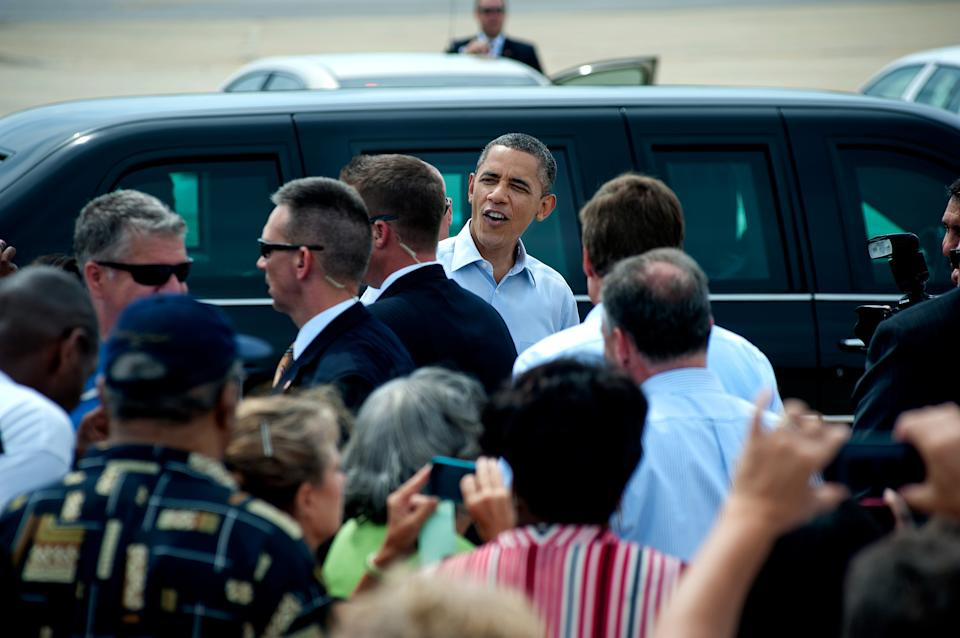 President Barack Obama meets with supporters after arriving aboard Air Force One at the Norfolk International Airport in Norfolk, Va., Friday, July 13, 2012.  (AP Photo/Rich-Joseph Facun)