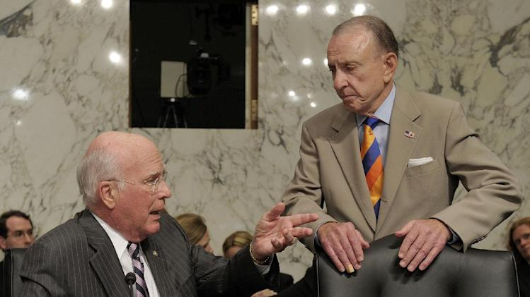 FILE - In a June 29, 2010 file photo, Senate Judiciary Committee Chairman Sen. Patrick Leahy, D-Vt., left, talks with committee member Sen. Arlen Specter, D-Pa., on Capitol Hill in Washington, during a break in Supreme Court nominee Elena Kagan's confirmation hearing before the committee.  Former U.S. Sen. Arlen Specter, longtime Senate moderate and architect of one-bullet theory in JFK death, died Sunday, Oct. 14, 2012.  He was 82. (AP Photo/Susan Walsh, File)