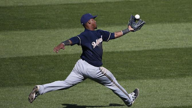 Brewers' Segura leaves game with apparent injury