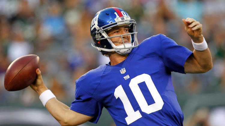 New York Giants quarterback Eli Manning throws a pass against the New York Jets during the first half of a preseason NFL football game on Saturday, Aug. 18, 2012, in East Rutherford, N.J. (AP Photo/Rich Schultz)