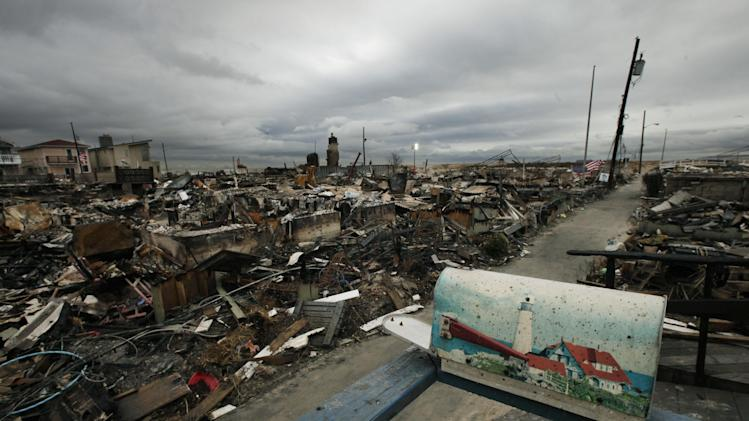 A mailbox with a lighthouse design sits on the porch of a burned out home in the Breezy Point section of Queens borough of New York,  Tuesday, Nov. 13, 2012. More than 50 homes were lost in a fire that swept through the oceanside community during Superstorm Sandy. (AP Photo/Mark Lennihan)