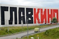A van pass by a Glavkino film studios sign located outside Moscow. The Russian company has spent $89mn building eastern Europe's largest production facilities in a field outside Moscow and hopes to lure Hollywood majors to shoot and produce movies