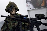 A dummy dressed as a soldier wears night vision binoculars at the Israel Defense exhibition in Tel Aviv on October 12, 2009. Talks resume Monday on a United Nations treaty to regulate the sale of conventional arms -- amid roadblocks put up by some of the world's key players.