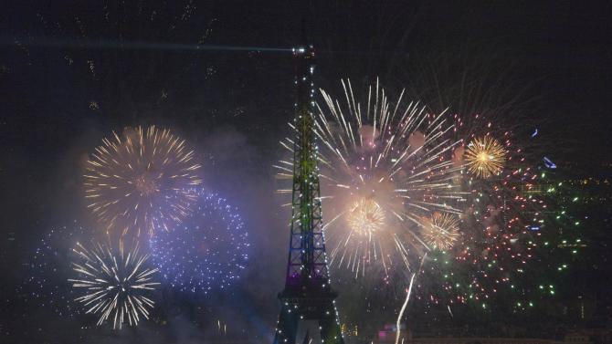 Fireworks illuminate the Eiffel Tower in Paris during Bastille Day celebrations late Sunday, July 14, 2013. (AP Photo/Thibault Camus)