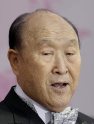 FILE - In this Wednesday, Oct. 14, 2009 file photo, Rev. Sun Myung Moon speaks during a mass wedding ceremony arranged by the church at Sun Moon University in Asan, South Korea. Rev. Moon, self-proclaimed messiah who founded the Unification Church, has died at age 92 church officials said Monday, Sept. 3, 2012. (AP Photo/ Lee Jin-man)