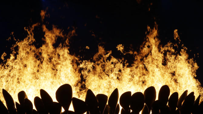 The Olympic cauldron is lit during the Opening Ceremony at the 2012 Summer Olympics, Saturday, July 28, 2012, in London. (AP Photo/David Goldman)