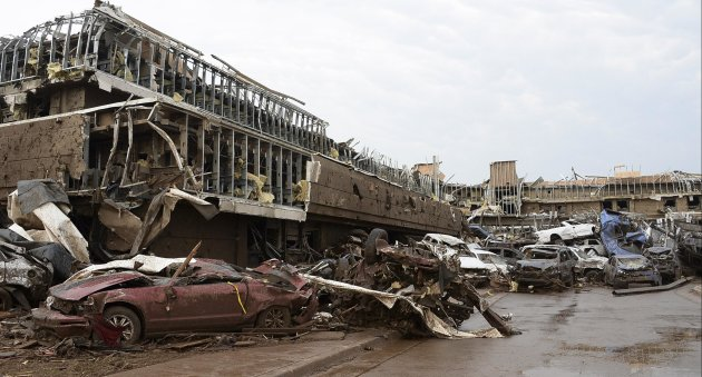 Damaged cars are seen in the parking lot of Moore Hospital after a tornado struck Moore, Oklahoma