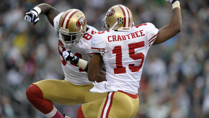 San Francisco 49ers wide receiver Josh Morgan (84) and wide receiver Michael Crabtree (15) celebrate Morgan's touchdown in the second half of an NFL football game against the Philadelphia Eagles on Sunday, Oct. 2, 2011 in Philadelphia. (AP Photo/Michael Perez)